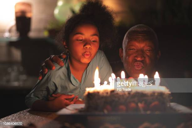 granddaughter celebrating birthday party - happy birthday stock pictures, royalty-free photos & images