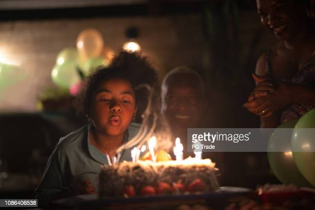granddaughter celebrating birthday party - birthday candles stock photos and pictures