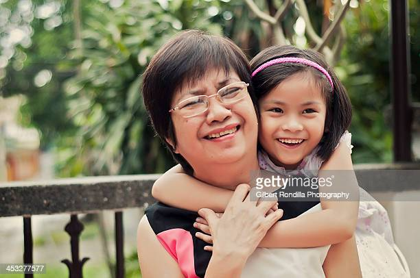 Granddaughter embracing grandmother