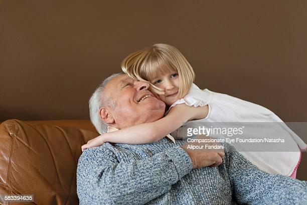 Granddaughter hugging Grandfather
