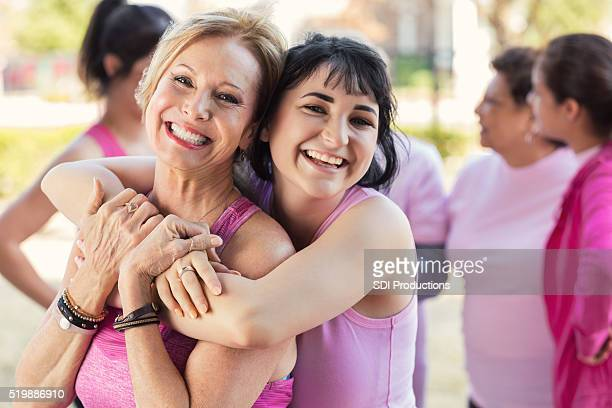 granddaughter hugs grandmother at charity fun run - survival stock pictures, royalty-free photos & images