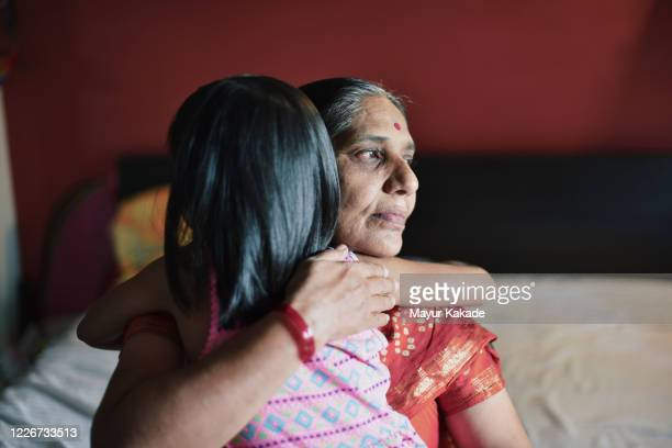 granddaughter hugs grandmother - indian culture stock pictures, royalty-free photos & images