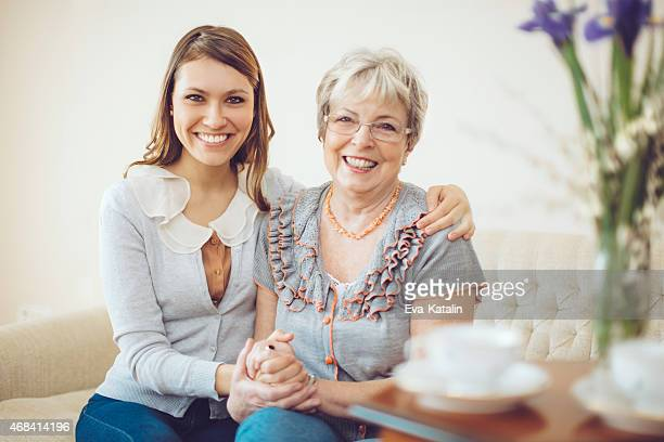 granddaughter is hugging her grandmother - beautiful grandmothers stock pictures, royalty-free photos & images