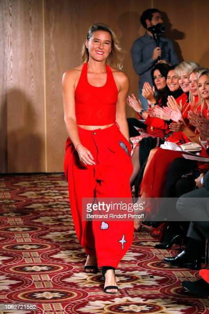 Granddaughter of Sean Connery Journalist Stephanie Renouvin dressed by Manish Arora Ignacia Zordan walks the runway during the Sauvez le Coeur des...