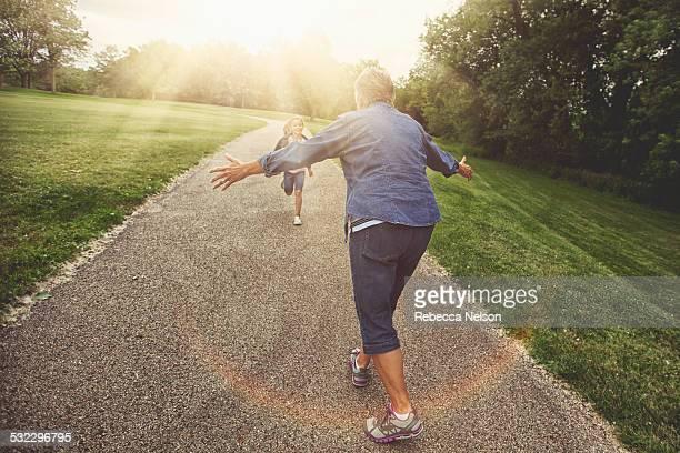granddaughter running to grandma for a hug