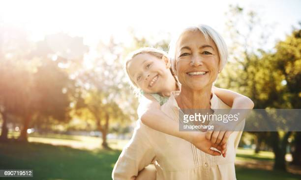 granddaughters, you gotta love 'em - grandmother stock pictures, royalty-free photos & images