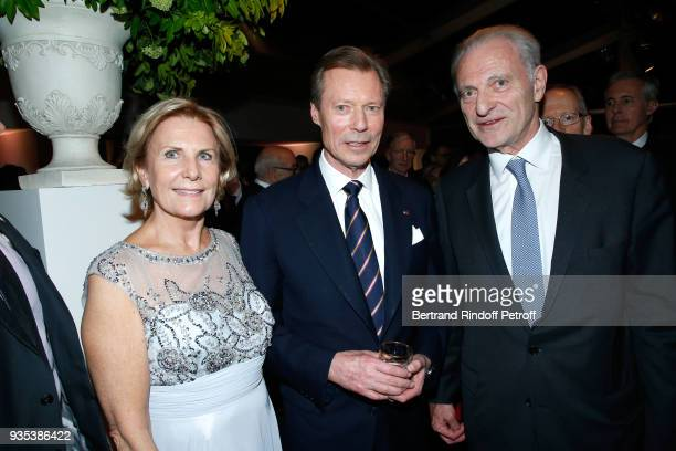 RR GrandDuc Henri of Luxembourg standing betwen Alain Flammarion and his wife Suzanna attend the Reception given by LLAARR GrandDuc Henri of...