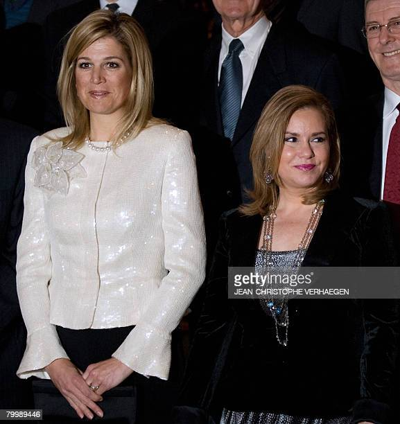 GrandDuchess MariaTeresa of Luxembourg stands beside Maxima Princess of Netherlands Princess of OrangeNassau and unidentified members of the UNAG...