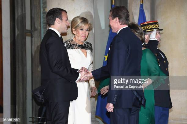 GrandDuke Henri of Luxembourg and GrandDuchess Maria Teresa of Luxembourg are greeted by French President Emmanuel Macron and Brigitte Macron as they...
