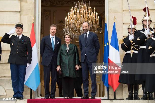 GrandDuke Henri of Luxembourg GrandDuchess Maria Teresa of Luxembourg and French Prime Minister Edouard Philippe pose at the Hotel de Matignon on...