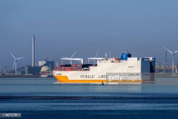Grande Amburgo, ro-ro cargo ship from Italian company Grimaldi Lines sailing on the Western Scheldt river in front of Vlissingen, Zeeland,...