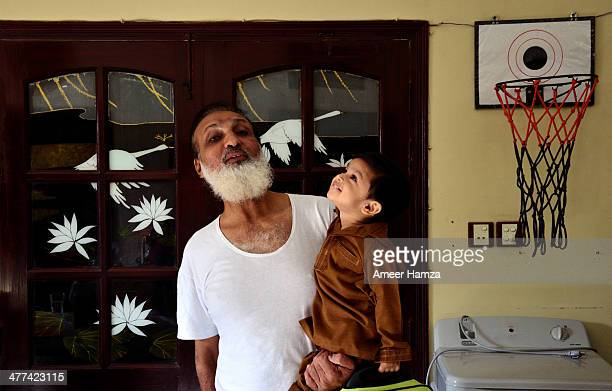grandfather and boy - cute pakistani boys stock photos and pictures