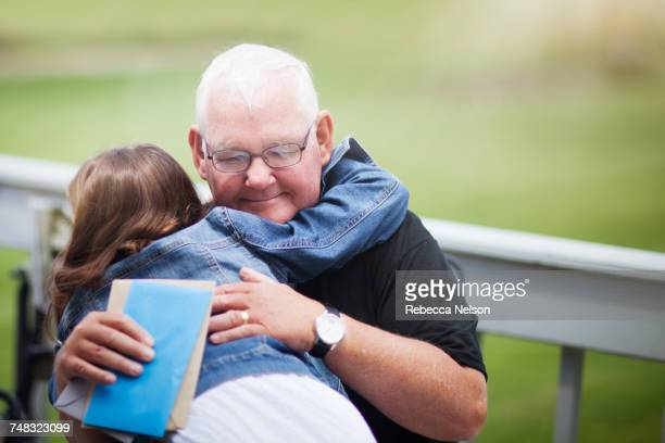 Grandfather and grandchild hugging