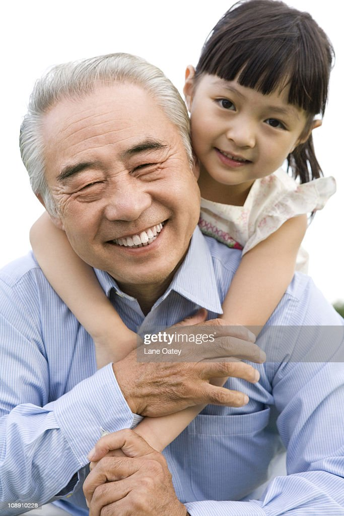 Grandfather And Granddaughter Enjoy A Day At The Park -8354