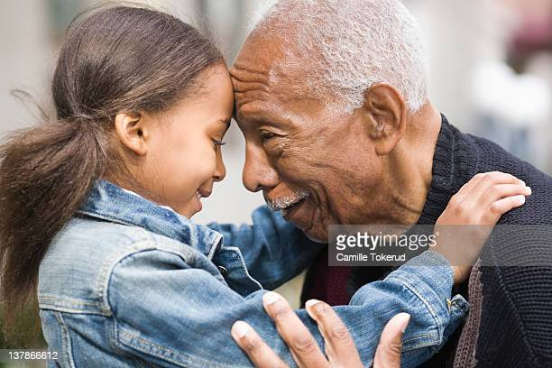 grandfather and granddaughter face to face - grandchild stock pictures, royalty-free photos & images
