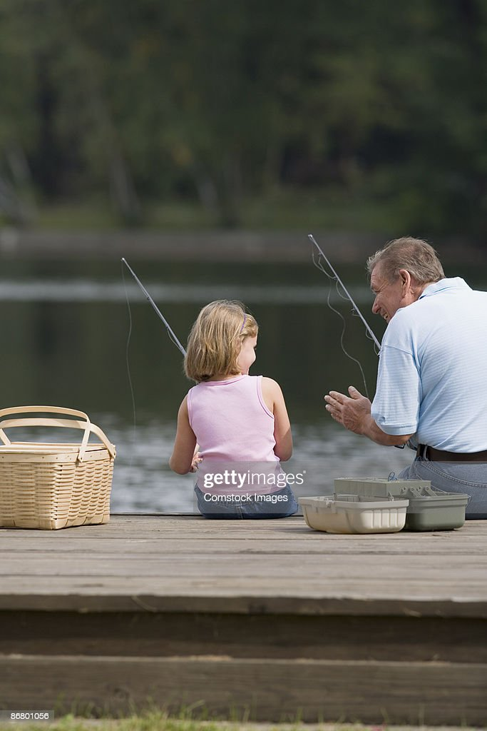 Grandfather And Granddaughter Fishing Stock Photo - Getty -5227