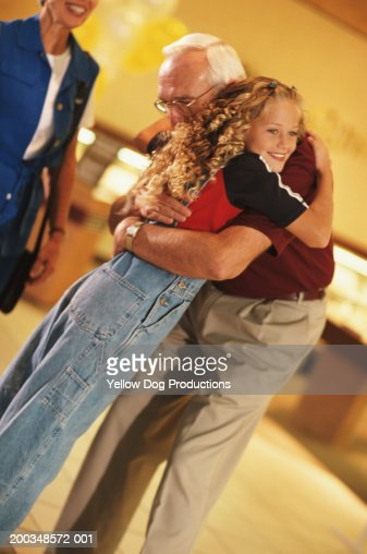 Grandfather And Granddaughter Hugging High-Res Stock Photo -5569