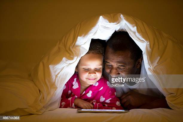 Grandfather And Granddaughter In Bed