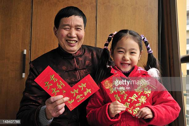 Grandfather and Granddaughter in Chinese New Year