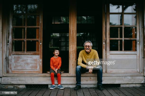 grandfather and granddaughter laughing at camera - 祖父 ストックフォトと画像