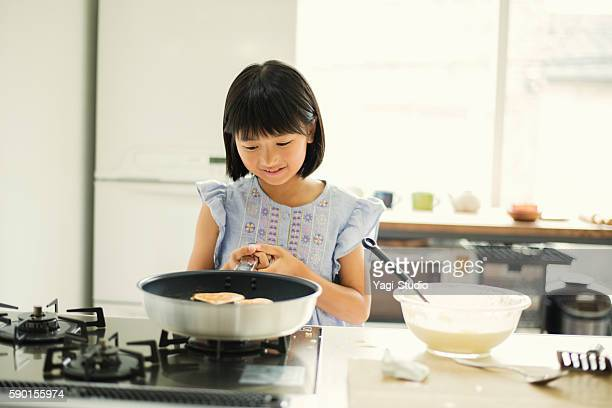 grandfather and granddaughter making a hot cake at home. - japanese girls hot stock photos and pictures