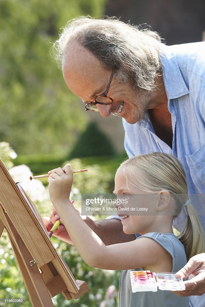 Grandfather And Granddaughter Painting High-Res Stock -5344