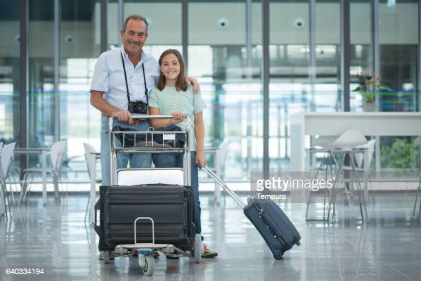 Grandfather and granddaughter ready for departure