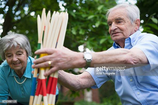 Grandfather and grandmother with giant pick up sticks