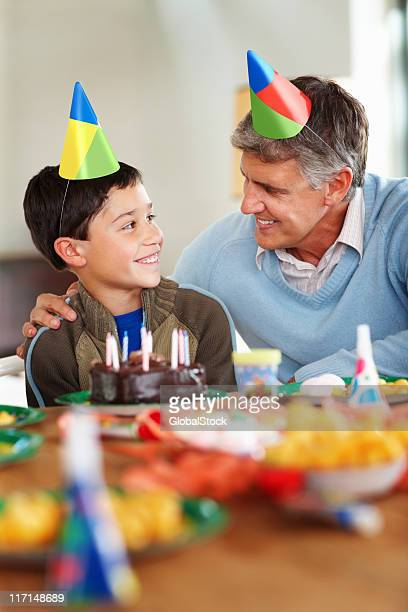Grandfather and grandson at birthday party