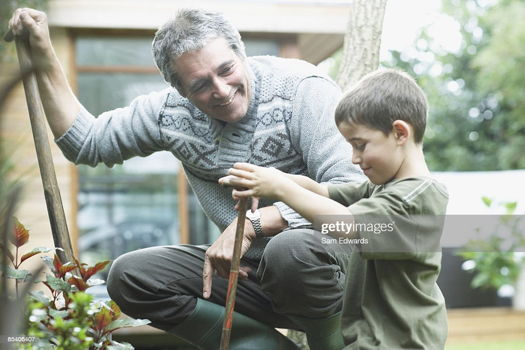 Grandfather and grandson gardening : Stock Photo