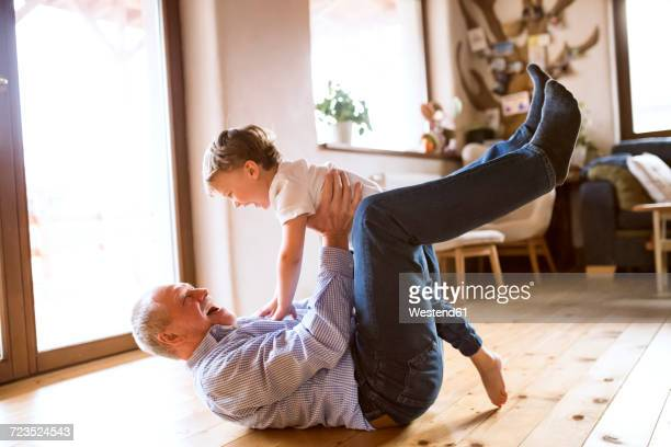 grandfather and grandson having fun at home - grandfather stock pictures, royalty-free photos & images