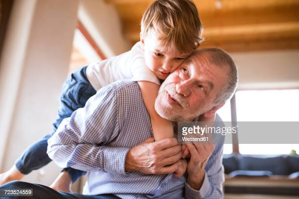 Grandfather and grandson having fun at home