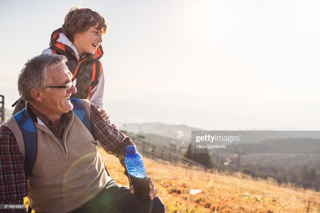 Grandfather and grandson in nature : Stock Photo