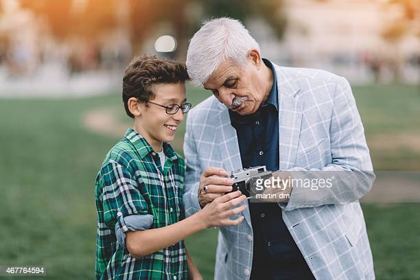 Grandfather and grandson in the city park