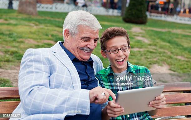 Grandfather and grandson in the park