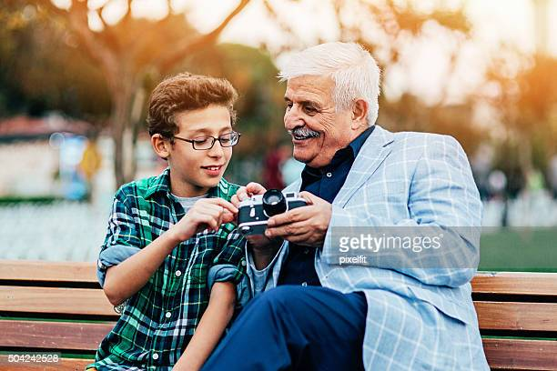 Grandfather and grandson learning craft