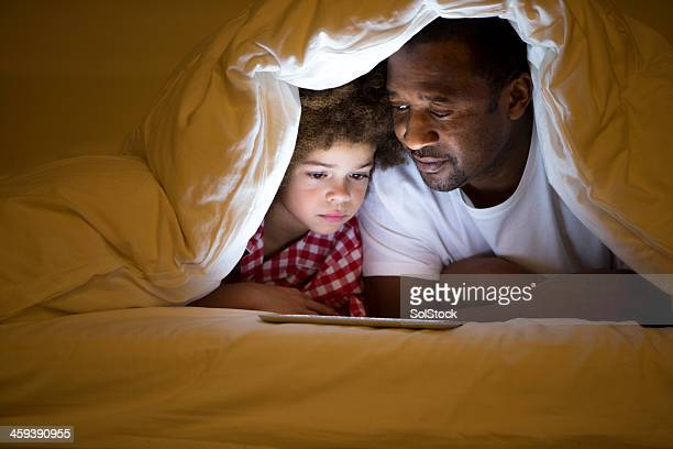 Grandfather and Grandson lying in bed