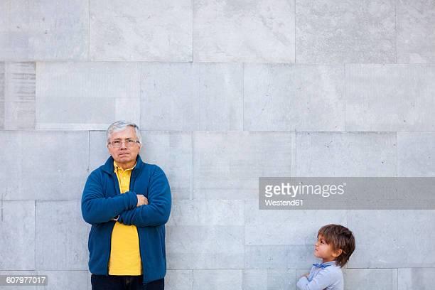 grandfather and grandson making funny faces - representar fotografías e imágenes de stock