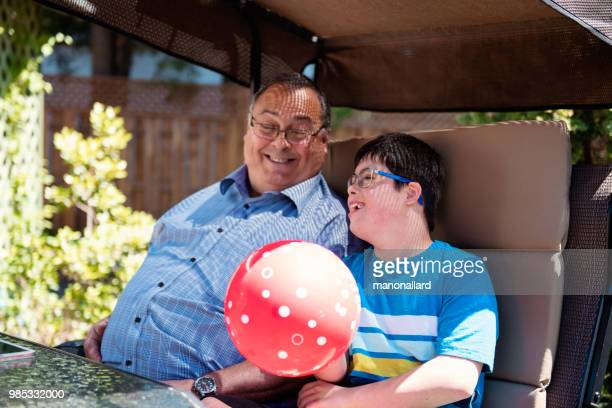 Grandfather and grandson of 12 years old with Autism and Down Syndrome in daily lives
