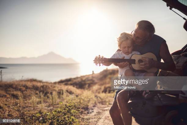 grandfather and grandson on the road trip - happy family in car stock photos and pictures