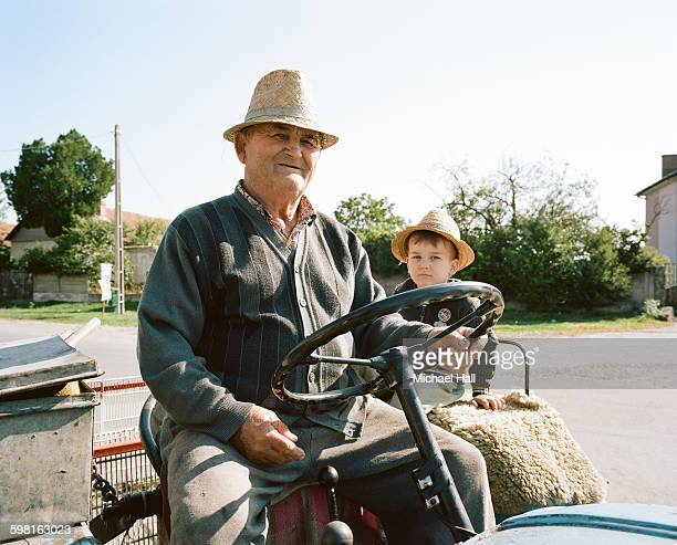 Grandfather and grandson on tractor