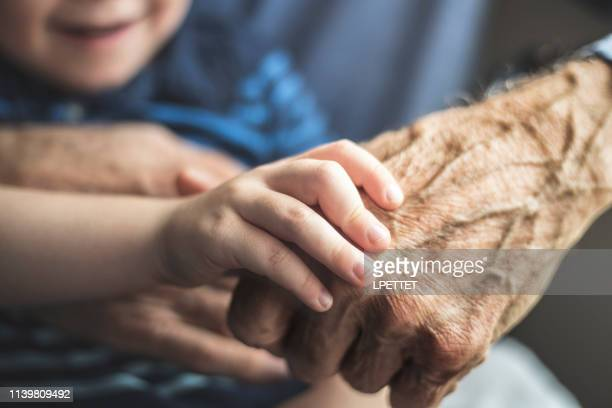 grandfather and grandson - hospice stock pictures, royalty-free photos & images