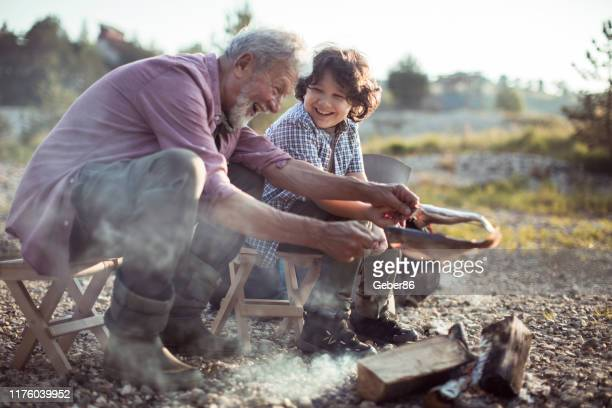 grandfather and grandson - fish love stock pictures, royalty-free photos & images