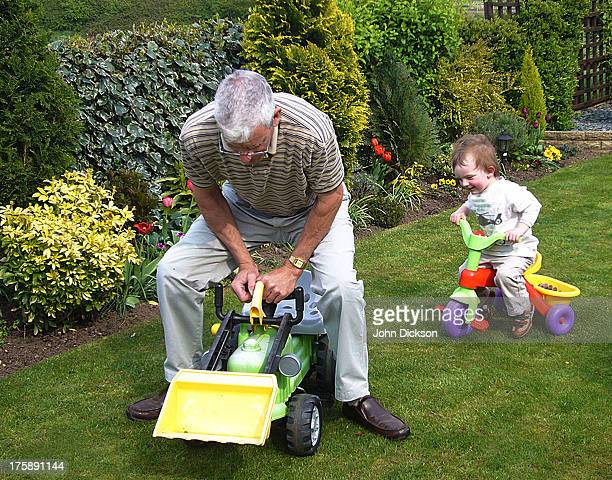 A Grandfather and Grandson playing in the garden