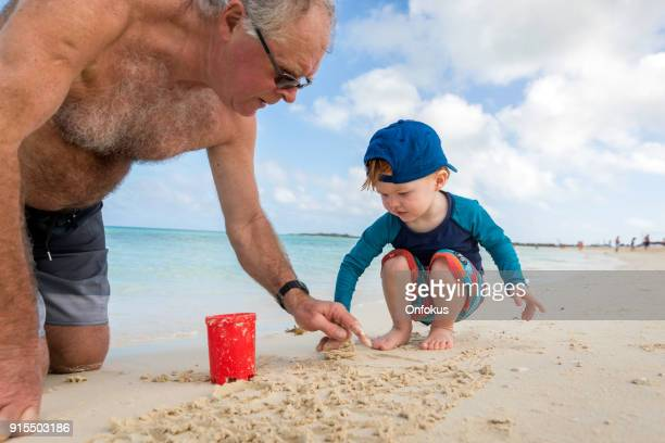 Grandfather and Grandson Playing on Tropical Beach of Cuba