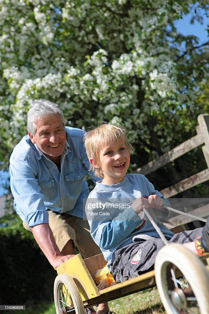 grandfather and grandson playing outside : Stock Photo