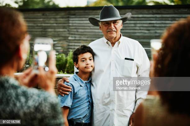 Grandfather and grandson posing for portrait after family dinner