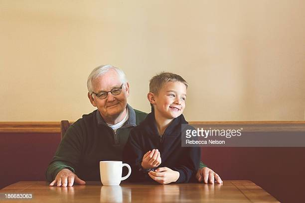 grandfather and grandson sharing a moment - rebecca nelson stock pictures, royalty-free photos & images