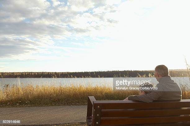 Grandfather and grandson sitting on bench