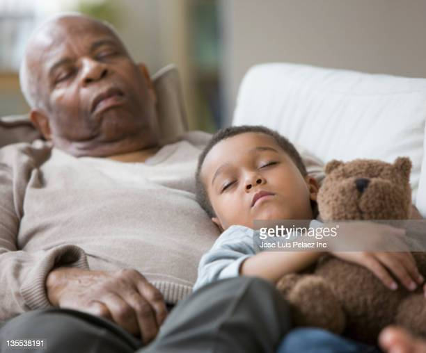 Grandfather and grandson taking a nap together